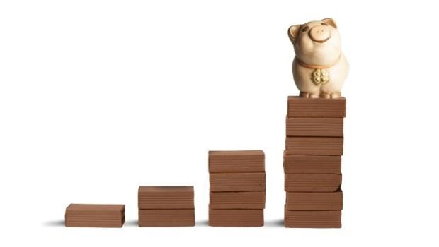 10年存100張金融股教學》每月1萬元買第一金,10年後年領8萬元股利!